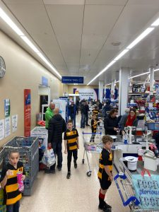 Under 10's Rugby Team fundraising by packing shopping bags at Tesco (Thornbury)